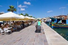 Marsaxlokk restaurant pier Stock Photography