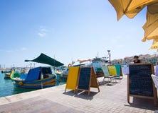 Marsaxlokk restaurant pier Royalty Free Stock Photos