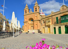 Marsaxlokk square - Malta. The parish church in the main square of Marsaxlokk, a fishing village in the south of Malta Royalty Free Stock Photography
