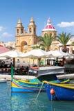 Marsaxlokk, uma aldeia piscatória maltesa tradicional, Malta Fotografia de Stock