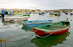 MARSAXLOKK VILLAGE, ISLAND OF MALTA. NOVEMBER 2, 2014. Rainy autumn day in  Marsaxlokk, ancient fishing village at the Mediterranean Sea and all seasons Royalty Free Stock Photography