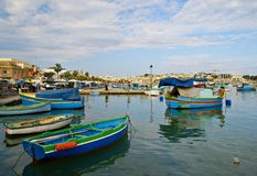 MARSAXLOKK VILLAGE, ISLAND OF MALTA. NOVEMBER 2, 2014. Rainy autumn day in Marsaxlokk, ancient fishing village at the Mediterranean Sea and all seasons Stock Photography