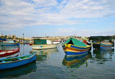 MARSAXLOKK VILLAGE, ISLAND OF MALTA. NOVEMBER 2, 2014. Rainy autumn day in  Marsaxlokk, ancient fishing village at the Mediterranean Sea and all seasons Royalty Free Stock Images