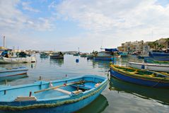MARSAXLOKK VILLAGE, ISLAND OF MALTA. NOVEMBER 2, 2014. Rainy autumn day in  Marsaxlokk, ancient fishing village at the Mediterranean Sea and all seasons Stock Images