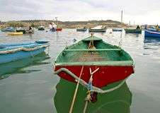 MARSAXLOKK VILLAGE, ISLAND OF MALTA. NOVEMBER 2, 2014. Rainy autumn day in Marsaxlokk, ancient fishing village at the Mediterranean Sea and all seasons Royalty Free Stock Image