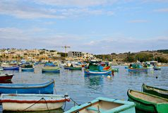 MARSAXLOKK VILLAGE, ISLAND OF MALTA. NOVEMBER 2, 2014. Rainy autumn day in Marsaxlokk, ancient fishing village at the Mediterranean Sea and all seasons Royalty Free Stock Photo
