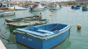 Marsaxlokk Village, Malta, July 6, 2016. Traditional maltese fishing boats . stock footage