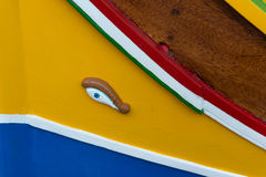 Marsaxlokk village, Malta. Luzzu, traditional eyed fishing boat in in Marsaxlokk village, Malta Royalty Free Stock Photography