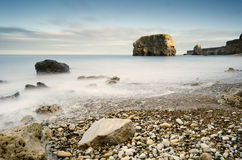 Marsden Rock in smooth water Stock Image