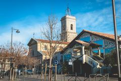 Architectural detail of the Saint Jean-Baptiste church and the La Fabrique media. Marseillan, France - December 30, 2018: architectural detail of the Saint Jean royalty free stock images