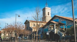 Architectural detail of the Saint Jean-Baptiste church and the La Fabrique media. Marseillan, France - December 30, 2018: architectural detail of the Saint Jean royalty free stock photos