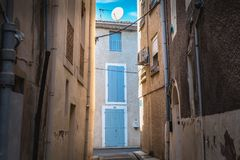 Architectural detail of small typical townhouses of Marseillan. Marseillan, France - December 30, 2018: architectural detail of small typical townhouses in the royalty free stock image