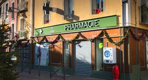 Front of a pharmacy in the city center of Marseillan. Marseillan, France - December 30, 2018: front of a pharmacy in the city center on a winter day stock photography