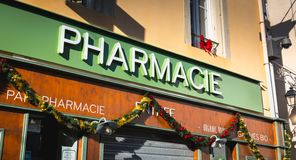 Front of a pharmacy in the city center of Marseillan. Marseillan, France - December 30, 2018: front of a pharmacy in the city center on a winter day royalty free stock image