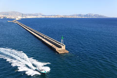 Marseille Breakwater and Pilot Boat. Marseille Breakwater and Approaching fast Pilot Boat Royalty Free Stock Image