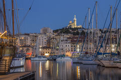 Marseille - Cote d'Azur - South of France. The Vieux Port of Marseille at night. Looking towards the Cathedral de Notre-Dame-de-la-Garde high on a hill Stock Photos