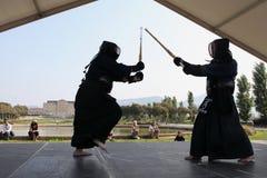 MARSEILLE, FRANCE - AUGUST 26: Japanese swords fight. Marseille. Festival Association on August 26, 2012 in Park Borelli, Marseille, France Royalty Free Stock Photo