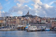 Old Habour Marseille With Notre Dame de la Garde In The Background stock photography
