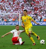UEFA EURO 2016 game Ukraine v Poland. MARSEILLE, FRANCE - JUNE 21, 2016: Jakub Blaszczykowski of Poland L fights for a ball with Yevhen Konoplyanka of Ukraine royalty free stock photo