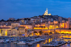 Marseille France night. Marseille, France at night. The famous european harbour view on the Notre Dame de la Garde Stock Photo