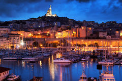 Marseille, France panorama at night. The famous european harbour view on the Notre Dame de la Garde Stock Images