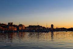 Marseille harbor at sunset royalty free stock photos