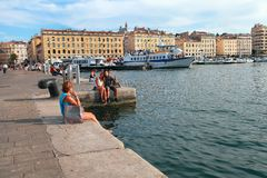 MARSEILLE - JULY 2, 2014: Old port (Vieux-Port) with people sitt Stock Image