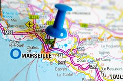 Marseille on map. Close up shot of Marseille or Marseilles on map with blue push pin stock images