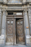 Ancient carved wooden door in one of the apartment houses stock photo
