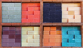 Marseille soap  in various fragrances displayed in a street market in public street on August 25 2013. NICE FRANCE - AUGUST 25: Marseille soap  in various Stock Photos