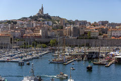 Marseille - South of France. The Vieux Port of Marseille. Looking towards the Cathedral de Notre-Dame-de-la-Garde high on a hill overlooking the city. Cote d' Stock Image