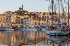 Marseille - South of France. The Vieux Port of Marseille. Looking towards the Cathedral de Notre-Dame-de-la-Garde high on a hill overlooking the city. Cote dAzur Stock Images