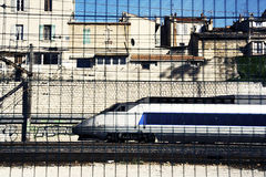 Marseille train. A train in marseille, shot through a mesh fence in the forground, then filtered royalty free stock images