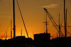 Marseilles Docks at sunset. A photo shot in the dying days of the French autumn down at the docks in Marseilles Royalty Free Stock Image