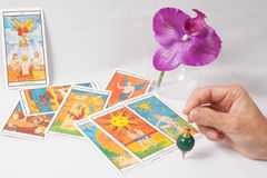 A Marseilles Tarot Decks,  divining rod, orchid. Marseilles Tarot Decks,  divining rod, orchid Royalty Free Stock Photography