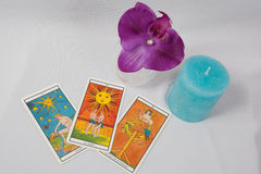 Marseilles Tarot Decks and orchid. A Marseilles Tarot card orchid and candle royalty free stock photo