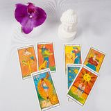 Marseilles Tarot Decks and orchid. A statue of buddha and Marseilles Tarot Decks and orchid stock photos