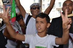 Marsella, Francia - 9 de agosto de 2014: Frunce del manifestante durante una demostración Imagen de archivo libre de regalías