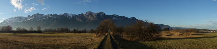 Marsh area and mountain chain Stock Photos