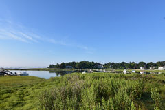 Marsh Grass Surrounding Duxbury Bay in Southeastern Massachusett. Scenic Duxbury bay on a warm summer day Stock Image
