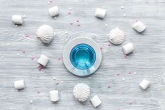 Marsh-mallow and tea for woman breakfast concept on wooden background top view Stock Photos