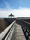 Marsh Walk in Southport, North Carolina. A wooden boardwalk through marsh grasses leads to a pagoda over the water in Southport, North Carolina Stock Photos