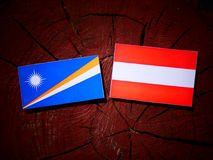 Marshall Islands flag with Austrian flag on a tree stump isolate Royalty Free Stock Images