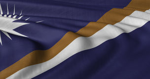Marshall Islands flag fluttering in light breeze Royalty Free Stock Image