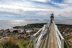 Marshall Point Light as seen from the rocky coast of Port Clyde, Stock Image