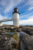 Marshall Point Light as seen from the rocky coast of Port Clyde,. Marshall Point lighthouse in Port Clyde, Maine. This lighthouse is known as the beacon actor Stock Photography