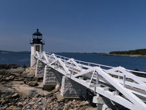 The Marshall Point Lighthouse. The famous Marshall Point Lighthouse stands guard on the Maine Coast also made famous in the hit Forrest Gump Movie Stock Photo