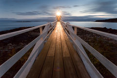 Marshall Point Lighthouse at sunset, Maine, USA. Very wide perspective Royalty Free Stock Image