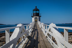 Marshall Point Lighthouse and walkway against a bright blue sky stock photos
