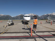 Marshalling an aircraft in Jackson Hole, Wyoming Airport Stock Images